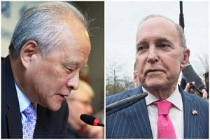 Cui Tiankai (left), China's ambassador to the US, and US President Donald Trump's top economic adviser, Larry Kudlow. Beijing's swift and forceful response raised the prospect of a quickly spiralling dispute between the world's two economic superpowe