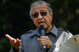 Former Malaysiam prime minister Mahathir Mohamad speaks during a rally organised by Bersih calling to stop a Bill to redraw electoral boundaries near the Parliament House in Kuala Lumpur on March 28, 2018.