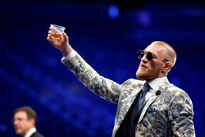 Mixed martial arts star Conor McGregor left a rival with facial injuries after attacking a shuttle bus carrying fighters from an Ultimate Fighting Championship media event in New York.