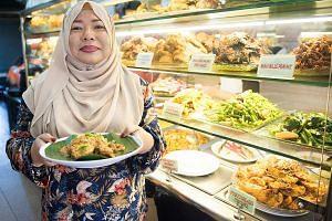Chicken rendang is a dish on the menu at Sinar Pagi Nasi Padang in Circular Road, which is run by Madam Ratnasari Abdul Rahman (above) and her husband.