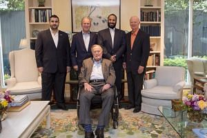 Saudi Crown Prince Mohammed bin Salman (second from right) posing with former US presidents George W. Bush (second from left), George H.W. Bush (centre) and former New York mayor Michael Bloomberg (right), in Houston on April 7, 2018.