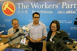 New WP chief Pritam Singh addressing the media yesterday with his predecessor Low Thia Khiang and chairman Sylvia Lim. Mr Singh said his immediate task is to reach out to party members for their views and vision for the party, adding that it was impo