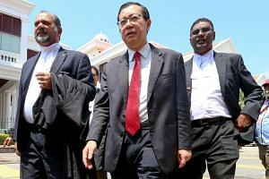 Penang chief minister Lim Guan Eng (centre) attending a court session in Penang on March 26, 2018.