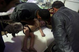 A child is treated in Douma, after what a Syria medical relief group claims was a suspected chemical attack.