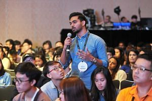 At the launch of Youth Conversations at Raffles City Convention Centre, young people asked questions at workshops and dialogues about matters that are a concern to them, such as job security, racism and climate action.