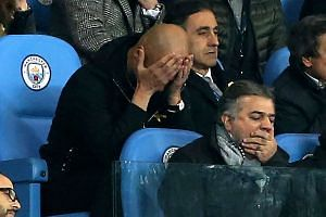 Guardiola (left) reacts on the tribune after being sent off the pitch.