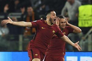 Roma's Greek defender Kostas Manolas (left) celebrates after scoring.