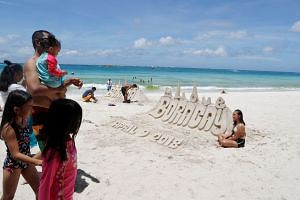 Sand sculptures are seen at a beach at Boracay in Philippines, on April 9, 2018.