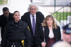 Mr Thomas Mesereau, Jr. (centre) arrives at the Montgomery County Courthouse for Bill Cosby's retrial, on April 9, 2018.