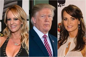 The FBI was looking for information related to adult-film star Stormy Daniels (left) and former Playboy model Karen McDougal (right) who have said they had sexual relationships with US President Trump.