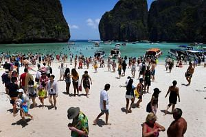 A crowd of tourists on the Maya Bay beach in the southern Thai island of Koh Phi Phi on April 9, 2018.