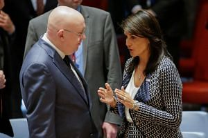 Haley talks with Russian UN Ambassador Vasily Nebenzya before the UN Security Council meeting on Syria.