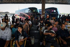 People waiting to take buses back to their hometowns at Mo Chit Bus Terminal the day before Songkran Festival in Bangkok on April 12, 2018.