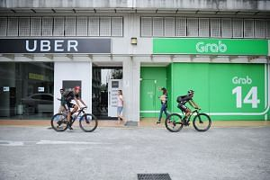 That Grab and Uber failed to notify Singapore's competition watchdog of their