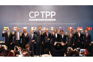 Representatives of members of Trans-Pacific Partnership (TPP) trade deal pose for an official picture after the signing agreement ceremony in Santiago, Chile on March 8, 2018.