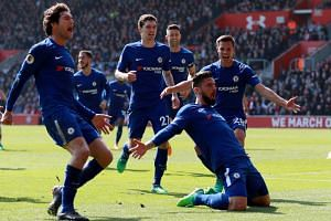 Chelsea's Olivier Giroud celebrates scoring their third goal during the English Premier League match againt Southampton on April 13, 2018.