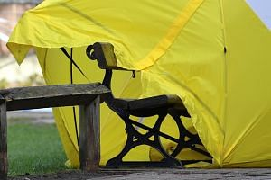 A tent is placed over the bench where former Russian spy Sergei Skripal and his daughter Yulia were found in Salisbury, Englang, in critical condition on March 4, 2018.