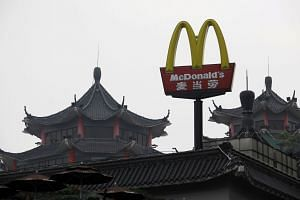 A file photo of a McDonald's sign displayed outside its outlet at the southern Chinese city of Shenzhen, on March 18, 2013.