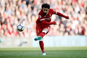 Liverpool's Mohamed Salah shoots at goal.