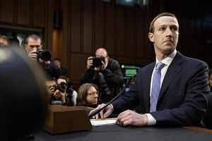 Facebook chief executive Mark Zuckerberg at a hearing in Washington last week. Mr Zuckerberg acknowledged Facebook had not done enough to protect private user data, but he also defended its opt-in provisions, which left it to users to decide what dat
