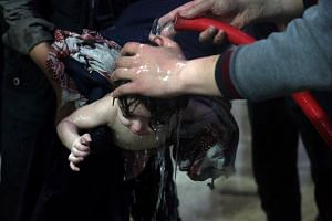 A child being treated in a hospital in Douma, Syria, after what a medical relief group claims was a suspected chemical attack on April 7, 2018.