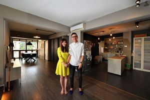 Ms Janet Ow, 41, and her husband Allen Wee, 39, in their five-room Telok Blangah Crescent flat. The property agents paid $580,000 for it in 2010 and started marketing it in 2016 at $680,000 to $690,000. Bids are coming in at $620,000 and $630,000, an