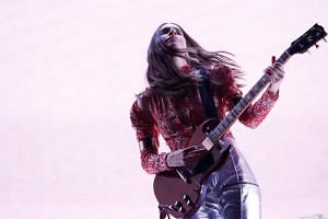 Danielle Haim of Haim performs at the Coachella Valley Music and Arts Festival in Indio, California.