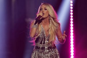 In the most anticipated performance of the night, Carrie Underwood emerged from five months of isolation following a fall at her home that required 40-50 stitches to her face.