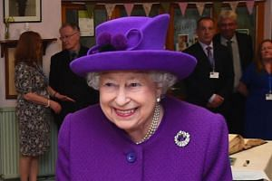 Britain's Queen Elizabeth II meets local residents during a visit to the King George VI Day Centre in Windsor, west of London on April 12, 2018.