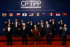 Representatives of members of Trans-Pacific Partnership (TPP) trade deal pose for a picture before the signing agreement ceremony in Santiago, Chile on March 8, 2018.