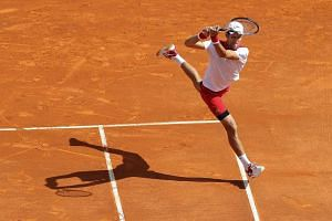 Serbia's Novak Djokovic returns a ball to compatriot Dusan Lajovic (not pictured) at the Monte-Carlo ATP Masters Series Tournament, on April 16, 2018 in Monaco.