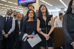 New York Times staff writers Jodi Kantor (left) and Megan Twohey listen as the 2018 Pulitzer Prizes are announced to the newsroom, on April 16, 2018.