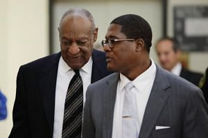 Actor Bill Cosby returns to the courtroom after a recess on the sixth day of his sexual assault retrial at the Montgomery County Courthouse in Norristown, Pennsylvania, on April 16, 2018.