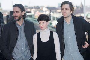 Director Fede Alvarez (left) and cast members Claire Foy (centre) and Sverrir Gudnason attending a photocall for the shooting of the new Millennium series film The Girl In The Spider's Web in Stockholm, Sweden, on April 13, 2018.