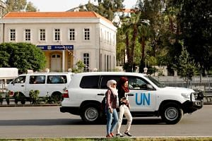 A United Nation vehicle carrying Organisation for the Prohibition of Chemical Weapons (OPCW) inspectors is seen in Damascus, Syria, on April 17, 2018.