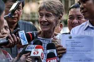 Australian nun Patricia Fox (centre) speaks to media after being released from custody at the Bureau of Immigration in Manila, Philippines, on April 17, 2018.