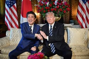 US President Donald Trump with Japanese Prime Minister Shinzo Abe at Trump's Mar-a-Lago resort in Palm Beach, Florida, on April 17, 2018.