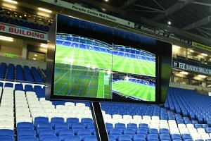 A Video Assistant Referee (VAR) system pitch-side is pictured prior to its use during the English FA Cup third round football match at the American Express Community Stadium in Brighton, southern England on Jan 8, 2018.