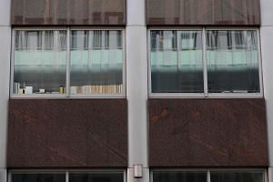 "Windows, one with the words ""Data"", ""Digital"", and ""Regulations?"" (left) are pictured on the second floor of a building which houses the offices of Cambridge Analytica, in central London."