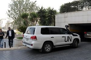 UN vehicles carrying a fact-finding mission team from the Organisation for the Prohibition of Chemical Weapons arriving at the Four Seasons hotel in Damascus, Syria, on April 14, 2018.