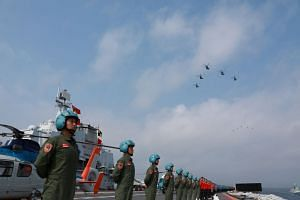 People's Liberation Army Navy personnel in a military display in the South China Sea earlier this month. The Chinese authorities have yet to release any details about yesterday's live-fire drills in the Taiwan Strait.