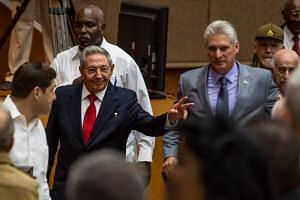 Cuban President Raul Castro (left) and First Vice-President Miguel Diaz-Canel (right) arrive for a National Assembly session that named the latter as the candidate to succeed Castro as president, in Havana on April 18, 2018.