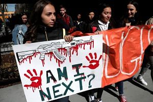 Students march out of their school in the Manhattan borough of New York City.
