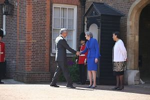 Prime Minister Lee Hsien Loong with British Prime Minister Theresa May and Secretary-General of the Commonwealth Patricia Scotland at Friary Court yesterday.