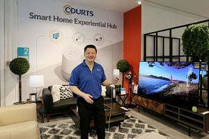 Mr Ben Tan, country CEO of Courts Singapore, demonstrating the Google Home at Courts Smart Home Experiential Hub at Courts Megastore, on April 20, 2018.
