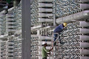 Workers inspecting the reverse osmosis trains at Singapore's fifth Newater plant at Changi.