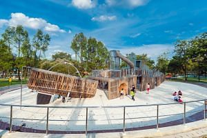 A life-sized shipwreck of wooden planks and galvanised steel, separated into five fractured pieces at the Sembawang Park playground.