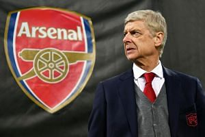 Wenger (above) is to stand down at the end of the season after a reign of almost 22 years.
