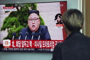 A South Korean man watches a news broadcast at a Seoul station, on North Korea's announcement to suspend its nuclear tests and shut down its nuclear facility, in Seoul, South Korea, on April 21, 2018.