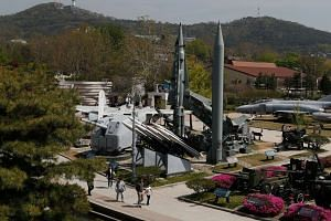 Visitors look at a North Korean Scud-B Tactical Ballistic Missile on display at the Korean War Memorial Museum in Seoul, South Korea, on April 21, 2018.